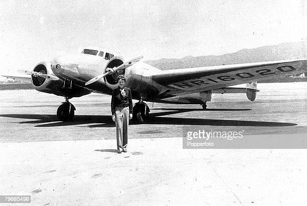 18th March 1937 American aviator Miss Amelia Earhart is pictured with her Flying Laboratory in which she is attempting to fly around the world from...