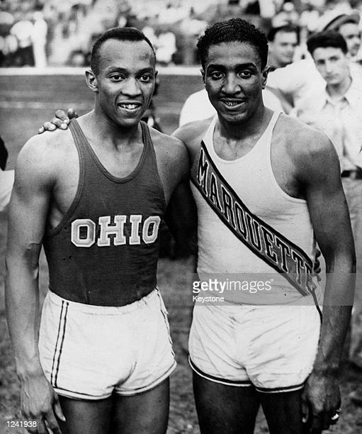 Jesse James Cleveland Owens on the left an American athlete the greatest sprinter of his generation who won four gold medals at the 1936 Olympics in...