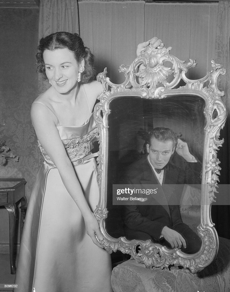 Photographer Lydia Heston with a photograph of her husband, American actor Charlton Heston.