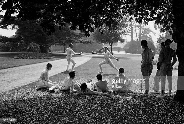 University students belonging to the fencing teams from Oxford and Cambridge Universities duelling in the picturesque surroundings of Ranelagh