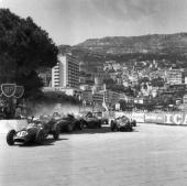 Cars contesting for space on the track at a closely fought corner in the early stages of the Monaco Grand Prix Roy Salvadori leads the pack in his...