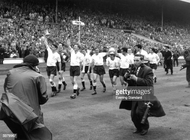 Tottenham Hotspur players carry the FA Cup trophy on a lap of honour after their 20 victory over Leicester City in the FA Cup final at Wembley...