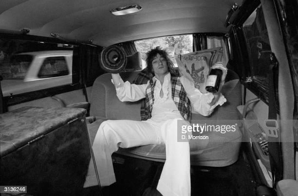 British singer Rod Stewart celebrates his Scottish parentage at a Scotland v England football match