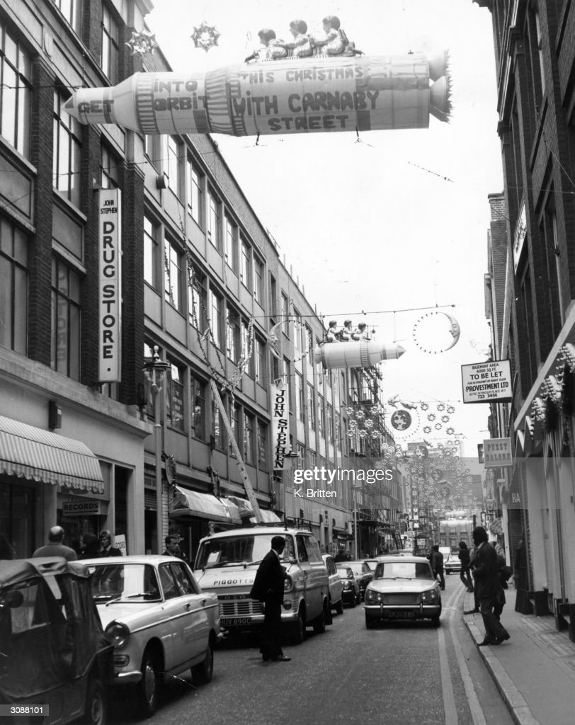 'Space travel' Christmas lights float over London's Carnaby street.