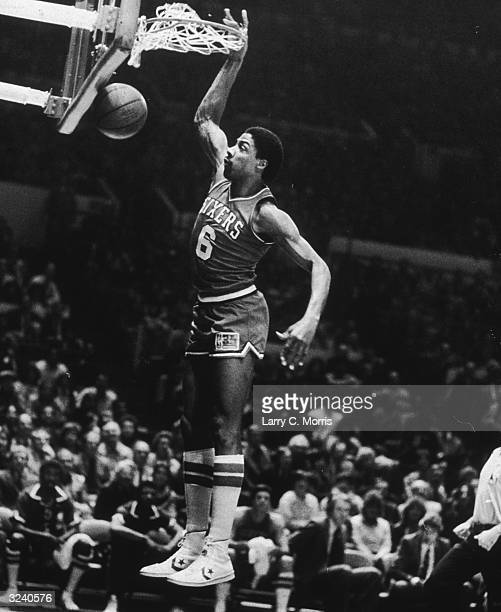 American basketball player Julius Erving aka 'Dr J' of the Philadelphia 76ers going up for 2 of his 30 points in a game against the New York Knicks...
