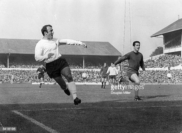 Footballer Jimmy Greaves of Tottenham Hotspur tries a shot at goal as Spurs play Newcastle United at White Hart Lane