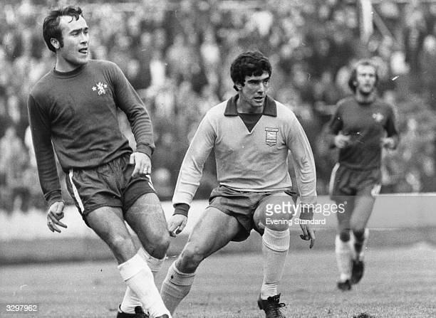 Footballers Ron Harris and Bryan Hamilton during a match