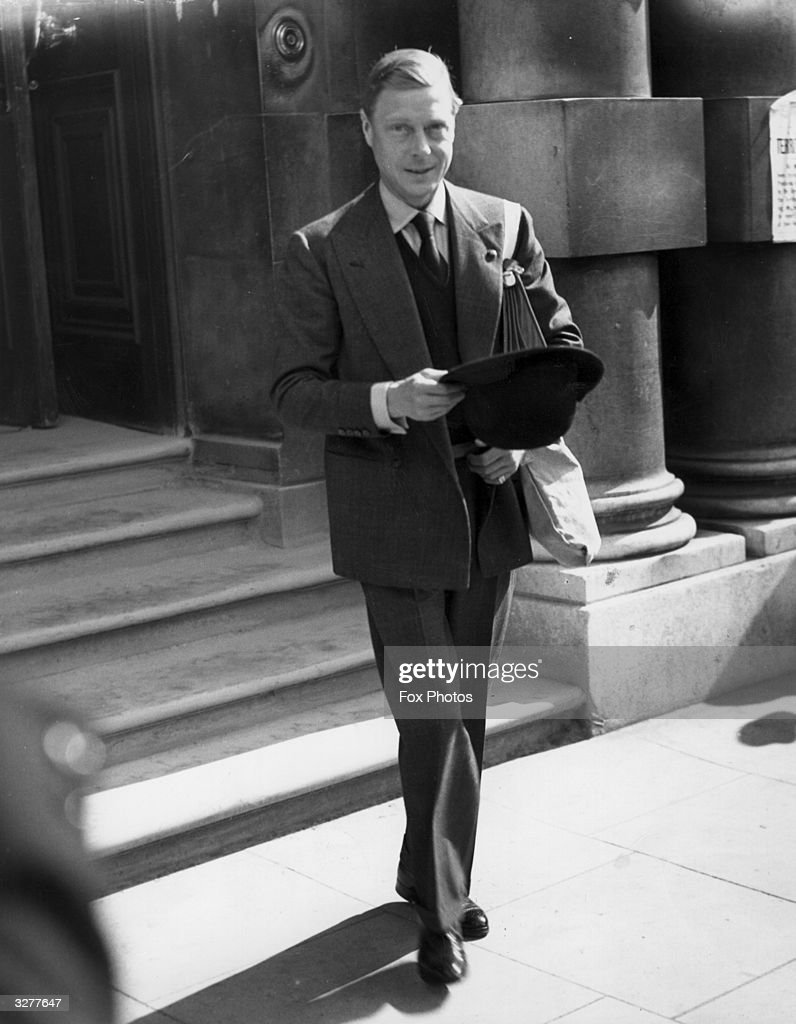 The Duke of Windsor leaves the War Office in Whitehall, London, carrying his gas mask.