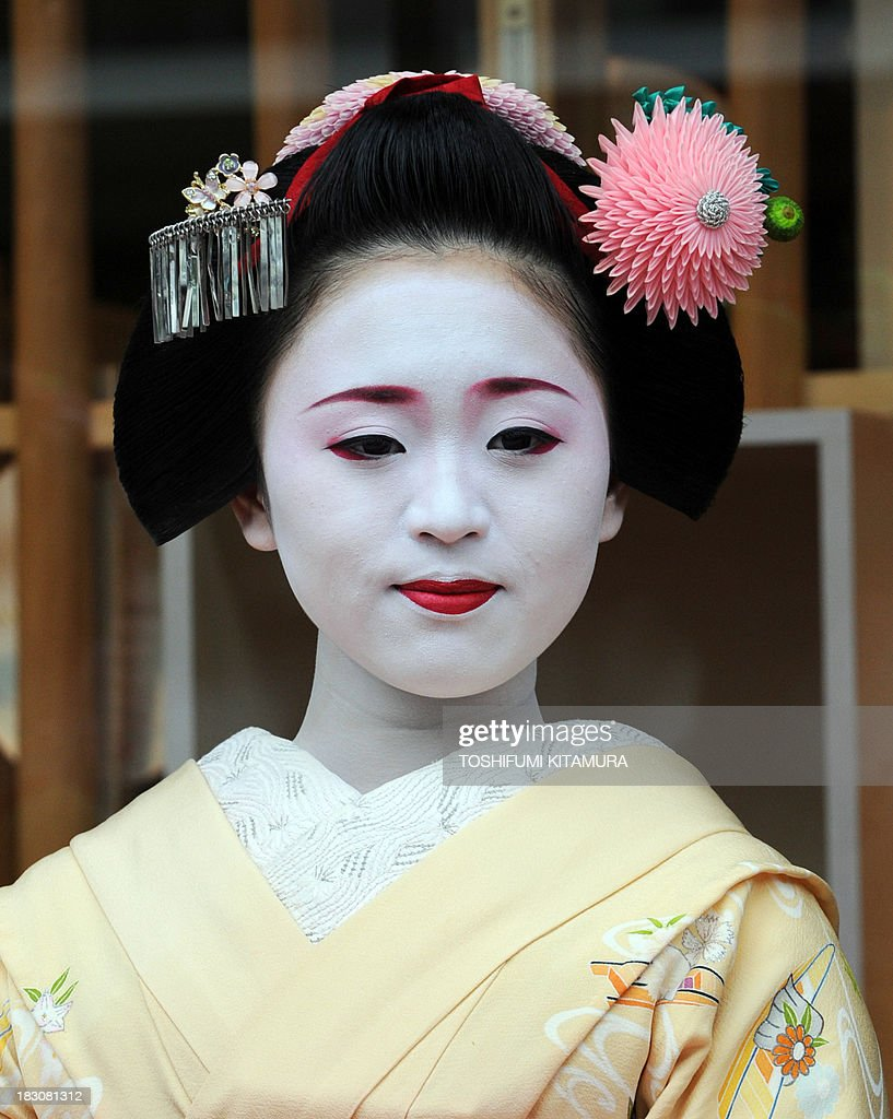 18-year-old Ichimari, a 'Maiko,' or apprentice geisha, from Kami Shichiken attends the 'We're alive and well, Kyoto' campaign in Tokyo on October 4, 2013. As Kyoto prepares itself for the biggest sightseeing season of autumn, the girls lent their charms to lure back tourists to the 1,200-year-old city after a big typhoon flooded some of scenic spots there three weeks ago.