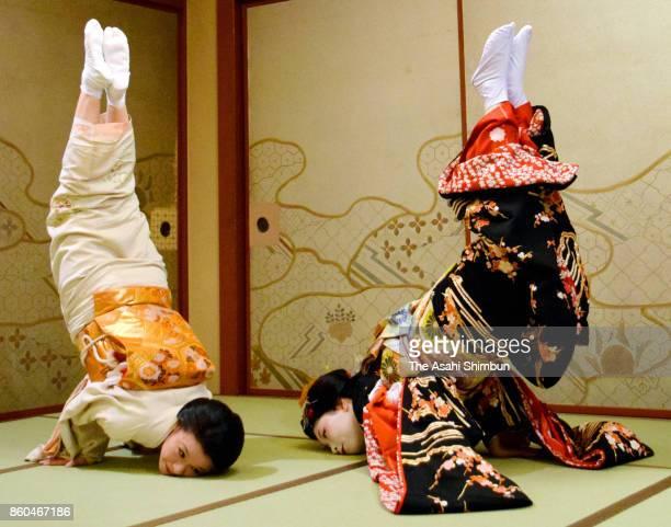 18yearold Makoto performs the 'KinnoShachihoko' handstand at her debut as Maiko apprentice of Geiko at ryotei traditional Japanese restaurant...