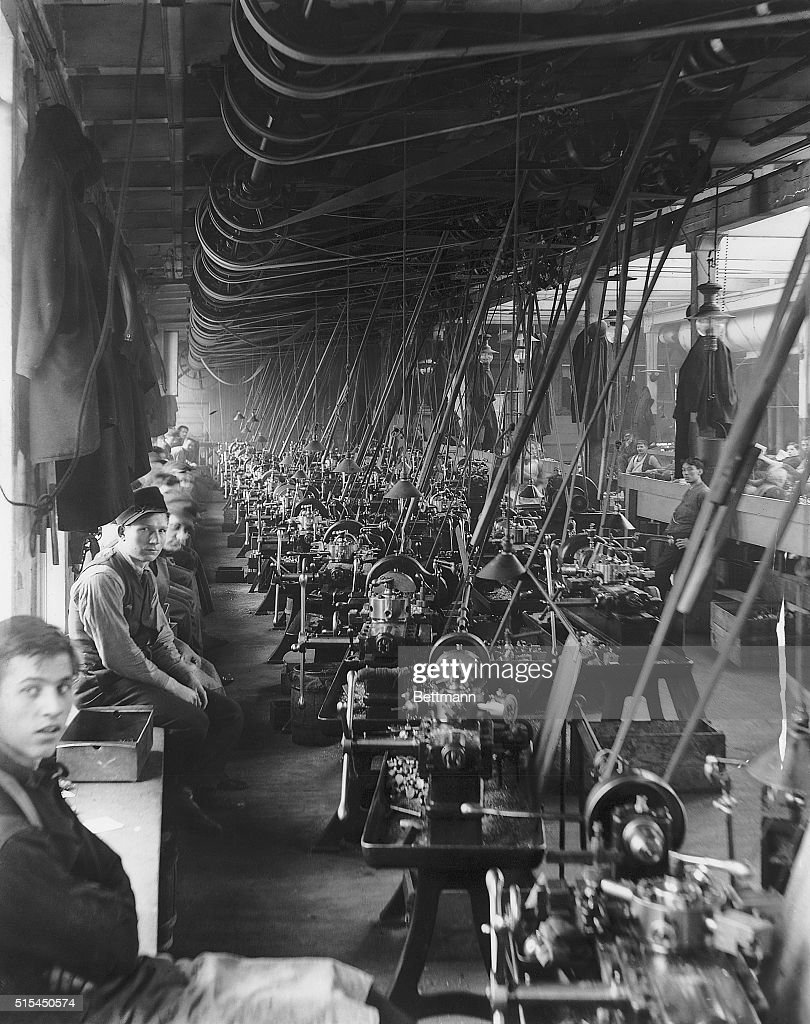 Workers are shown taking a break at the Cadillac automobile plant.