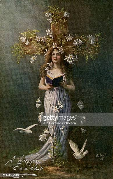 1910s Easter postcard featuring photograph of young woman holding book and standing before crucifix Surrounded by lilies and white doves
