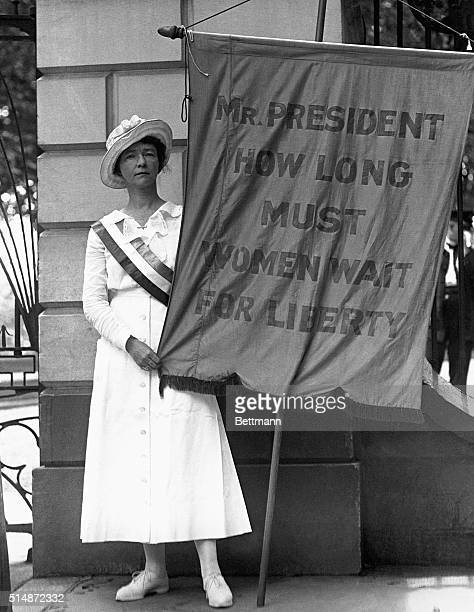 Mrs William L Colt of New York City who has just arrived at Washington where she is picketing the White House She had her baggage marker Nicholas...