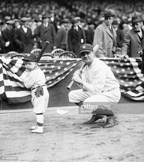 1920Babe Ruth in baseball field with moppet batter by his side