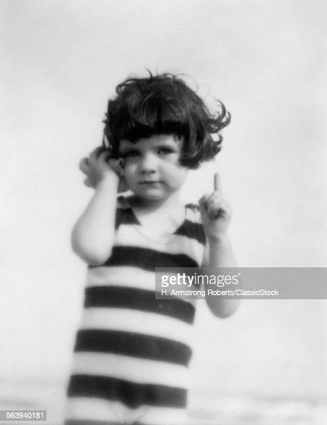 1920s GIRL IN STRIPED...