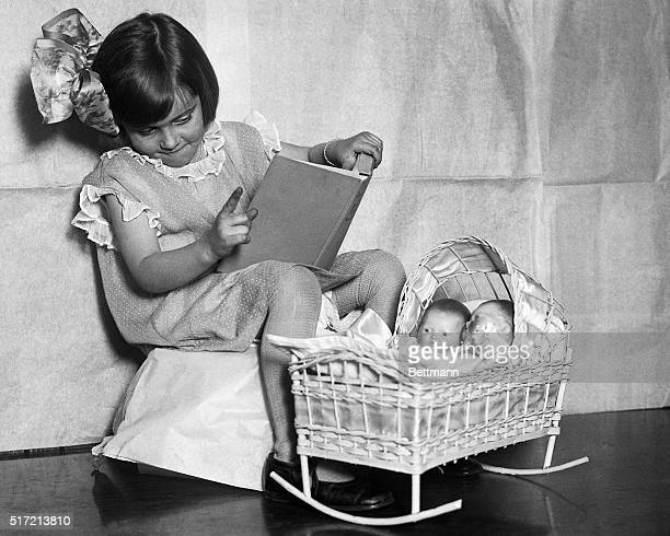 1925New York NY Little Miss Dorothy Lewis of New York believes in the bed time story hour for dollies She has heard a lot of them before going to...