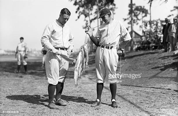 1927St Petersburg FL Portrait of Lou Gehrig and Bob Shawkey with a mess of trout that Shawkey caught and brought to the Yankees' training camp to...