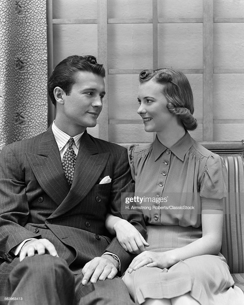 1930s 1940s COUPLE SITTING... : Stock Photo