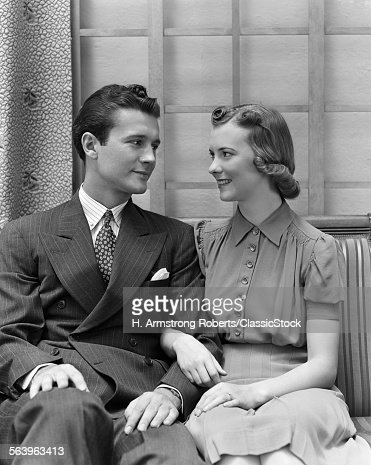 1930s 1940s COUPLE SITTING...