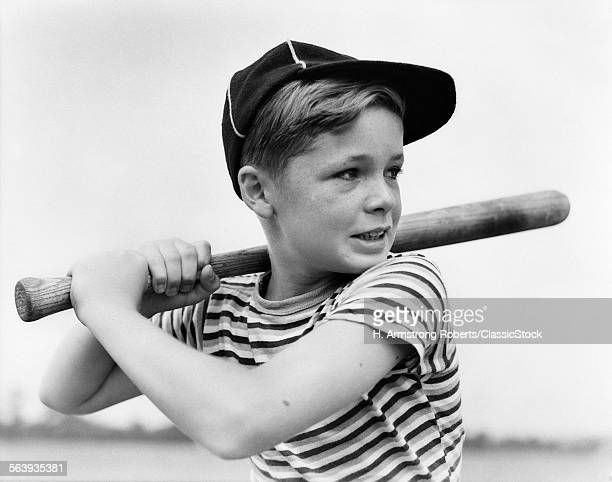 1930s BOY AT BAT WEARING A...