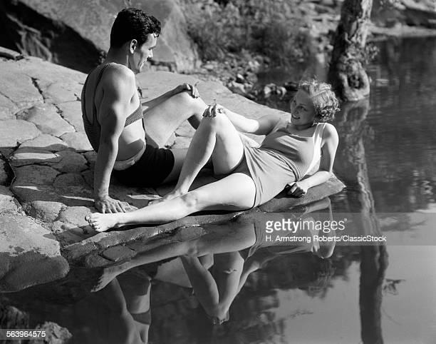1930s COUPLE LYING ON...