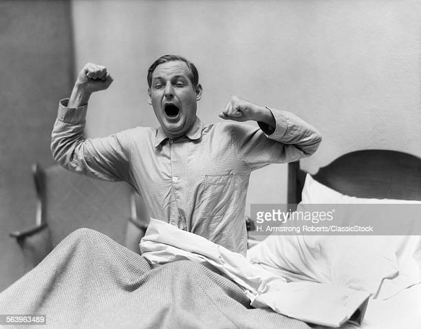 1930s MAN IN BED WAKING UP...