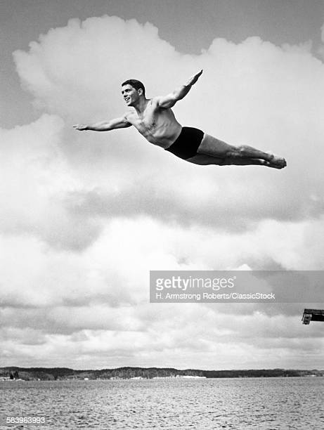 1930s MAN SWAN DIVING FROM...