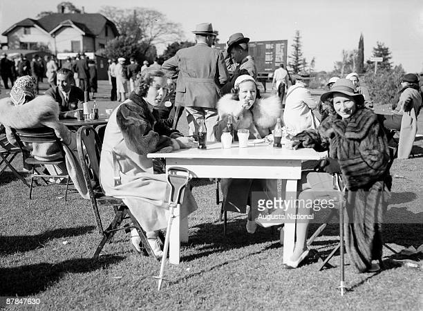 Patrons enjoy drinks on course during a 1930s Masters Tournament at Augusta National Golf Club in April in Augusta Georgia