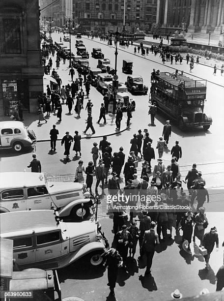 1930s PEDESTRIAN CROWD...