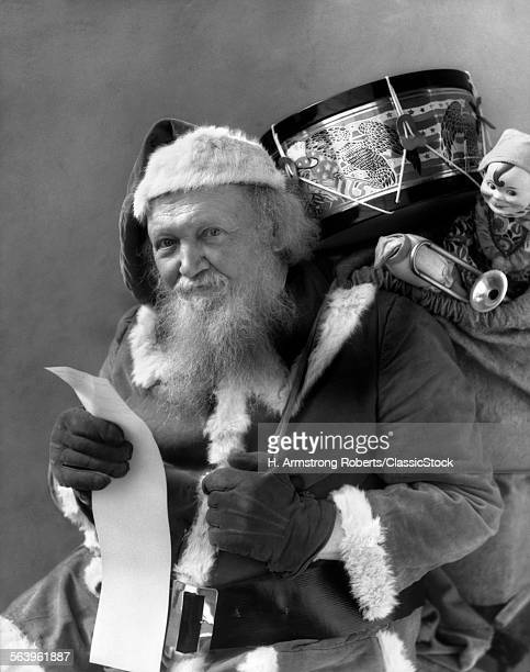 1930s SANTA WITH SACK OF...