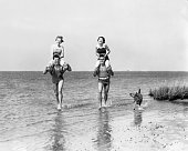 1930s TWO COUPLES RUNNING...