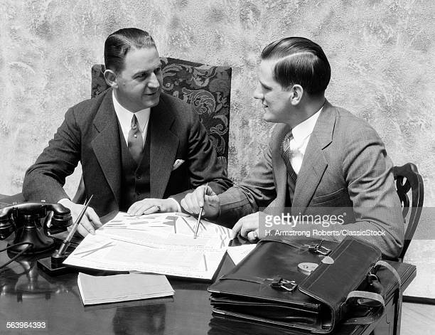 1930s TWO MEN SITTING ON...