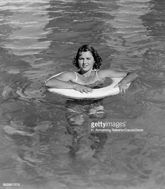 1930s WOMAN IN POOL IN...