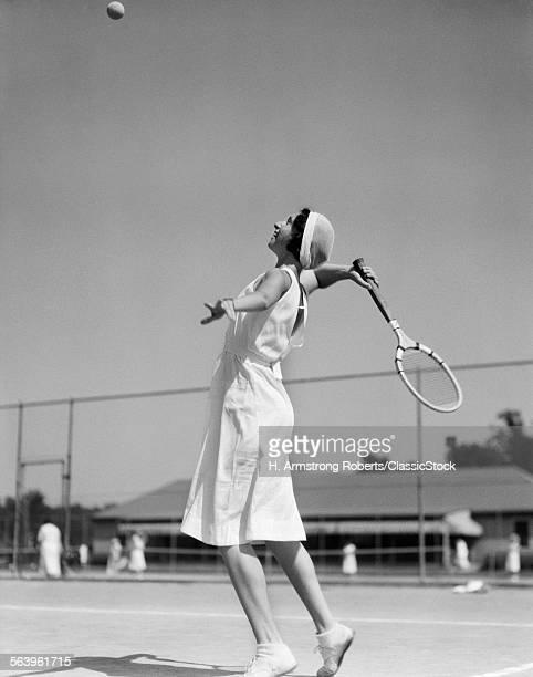 1930s WOMAN PLAYING TENNIS...
