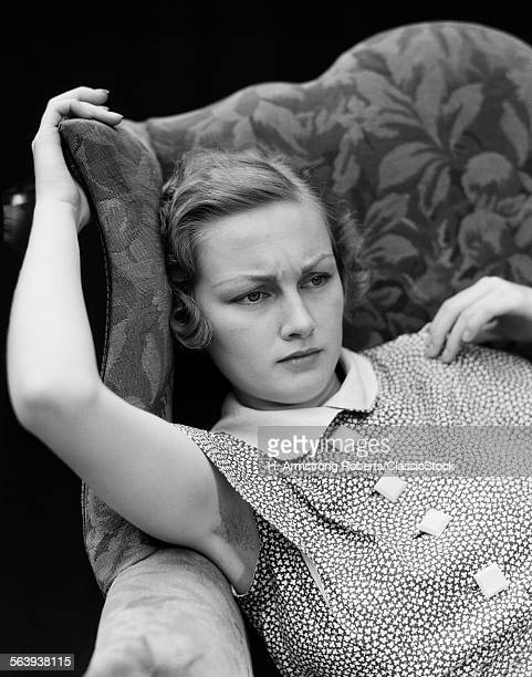 1930s WOMAN SITTING...