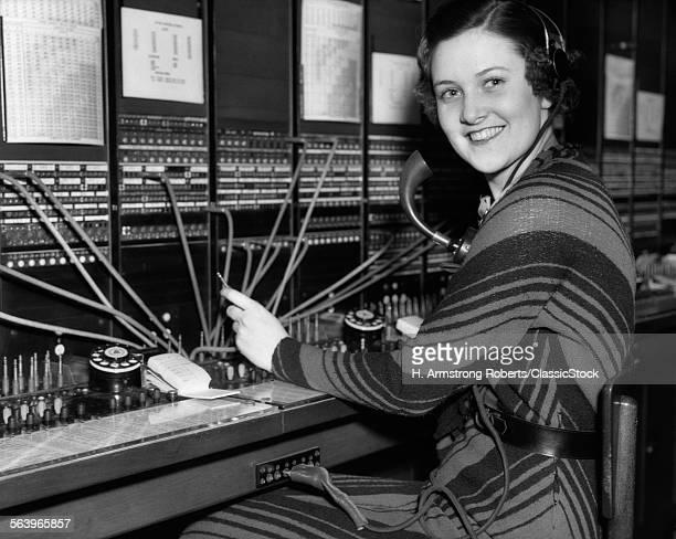 1930s WOMAN TELEPHONE...