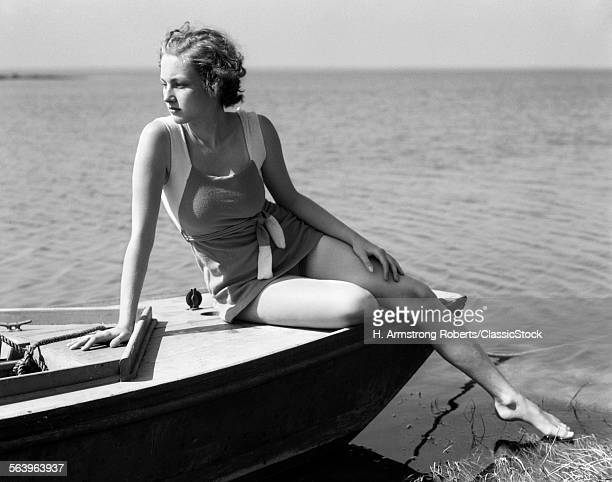 1930s WOMAN WEARING ONE...