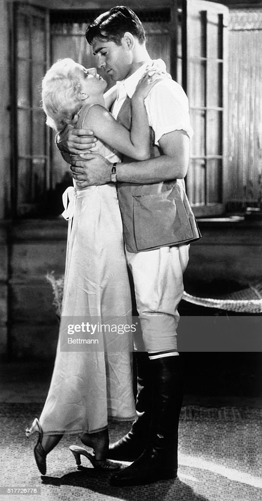 The terrific heat and blinding dust storms of indo-China provide tropical atmosphere for love scenes between <a gi-track='captionPersonalityLinkClicked' href=/galleries/search?phrase=Jean+Harlow&family=editorial&specificpeople=70012 ng-click='$event.stopPropagation()'>Jean Harlow</a> as Vantine and <a gi-track='captionPersonalityLinkClicked' href=/galleries/search?phrase=Clark+Gable&family=editorial&specificpeople=70015 ng-click='$event.stopPropagation()'>Clark Gable</a> as 'Dennis', foreman of a huge rubber plantation in 'Red Dust', an M.G.M. production.
