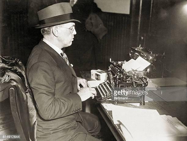 1935Damon Runyon American journalist and writer is shown typing at a typewriter Picture taken at Flemington NJ