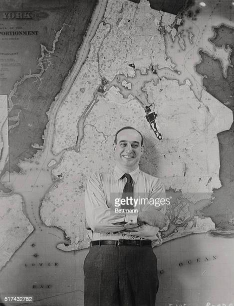 Portrait of New York City Park Commissioner Robert Moses standing in front of a giant city map at 80 Center Street