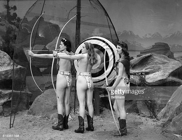 1939San Francisco CA Sally Rand girls take aim during archery at the Nude Ranch