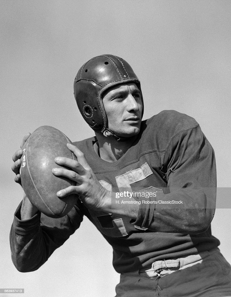 1940s 1950s MAN FOOTBALL... : Stock Photo