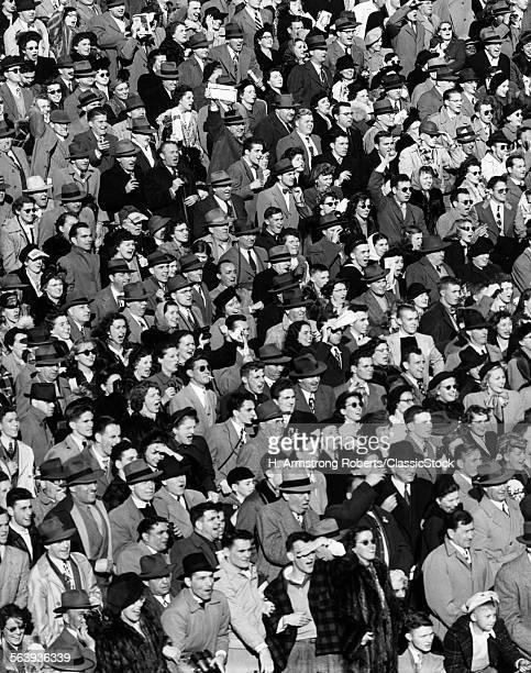 1940s CROWD IN BLEACHERS...