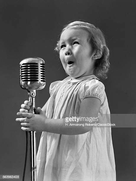 1940s LITTLE GIRL MAKING...