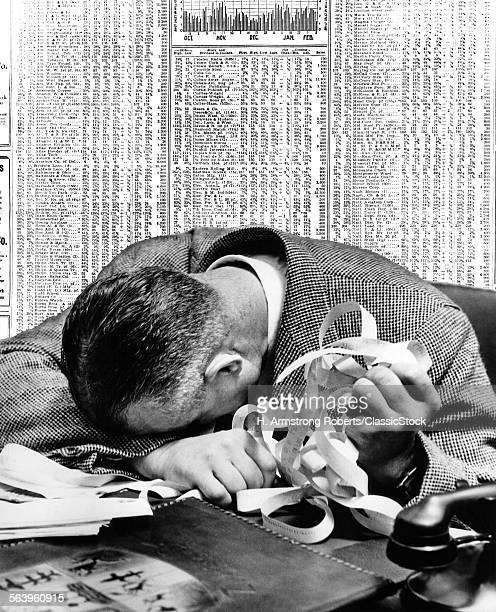 1940s MAN HEAD ON DESK...
