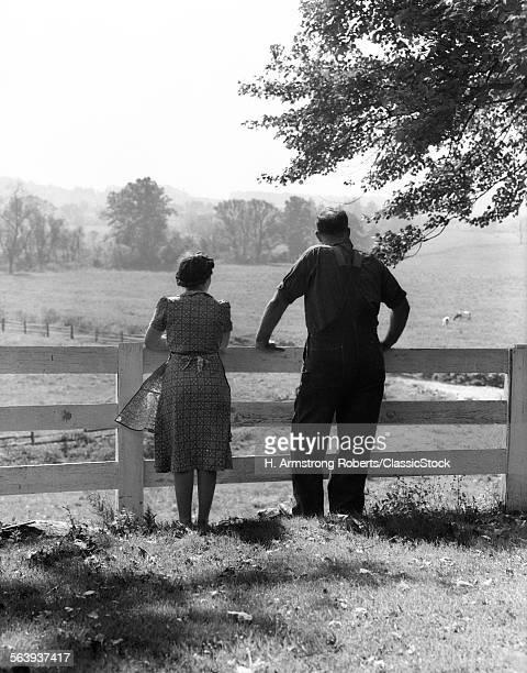 1940s REAR VIEW OF ELDERLY...