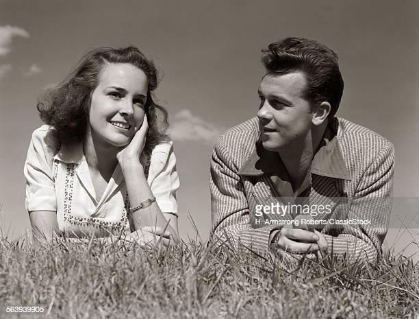 1940s TEENAGE COUPLE LYING...