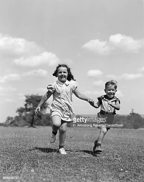 1940s TWO SMILING CHILDREN...