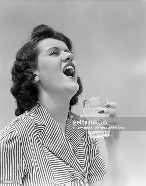 1940s WOMAN GARGLING...