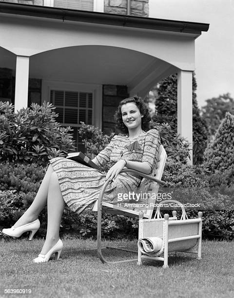 1940s WOMAN HOLDING BOOK...